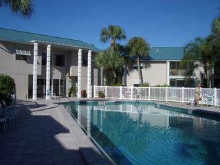 Siesta Key condo photo - Beautiful heated secluded pool with restrooms