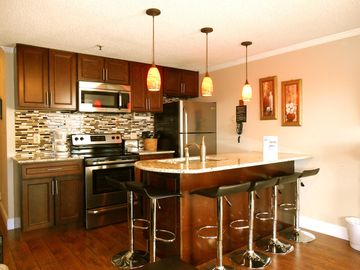 Snowshoe Mountain condo rental - Completely remodeled kitchen w/ granite counter, eating island, stainless steel