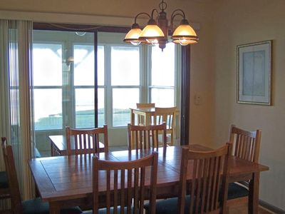 Dining Area overlooks sunroom and the ocean.