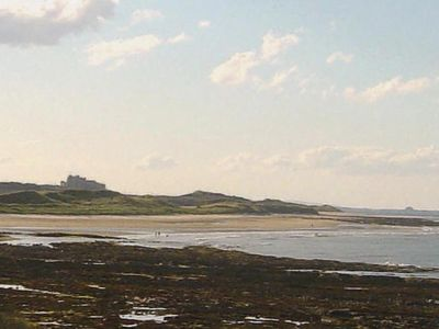 View Bamburgh Castle and Holy Island from the Harbour.