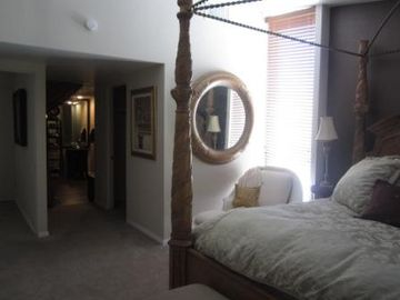 master bedroom, king size bed, two large walk in closets...