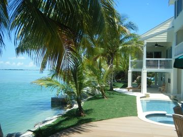 Summerland Key house rental - Backyard is shaded with lots of teak furniture