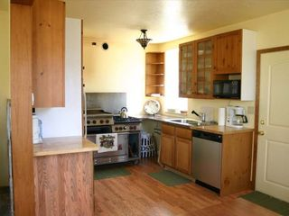 Salida house photo - modern, well stocked kitchen with door to backyard