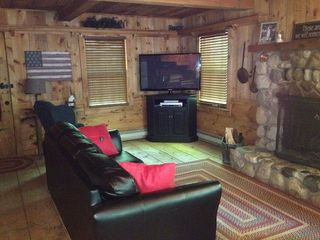 White Cloud cabin photo - Relax and enjoy the game and a nice fire...