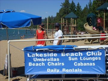 LAKESIDE BEACH UMBRELLA & CHAIR RENTALS, PLAYGROUND IN THE BACKGROUND