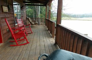 back porch comfort in TN - Muddy Pond cabin vacation rental photo