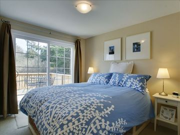 The master bedroom with queen and pillow top mattress, with private deck.