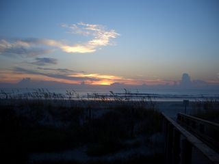 St. Augustine Beach condo photo - Get your coffee and sit on the beach ramp deck! Awesome sunrises!