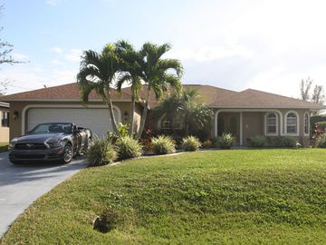 Front of the house, 2 car garage in a quiet south west Cape Coral neighborhood.