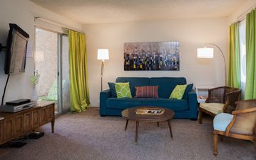 Old Town Scottsdale condo rental - Living area with retro furnishings and comfortable sofa sleeper