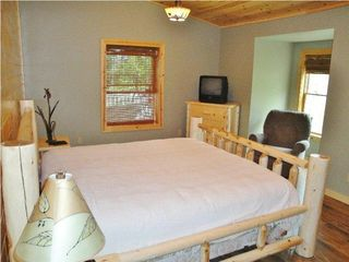 Burt Lake cabin photo - Large master bedroom with vaulted ceiling and TV ... House sleeps 8 (Max)
