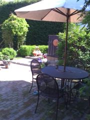 Newport house photo - Enjoy the private patio for drinks, dining, or relaxing in the warm sunshine.