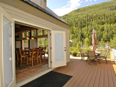 The spacious entertaining area opens to a huge riverfront deck.