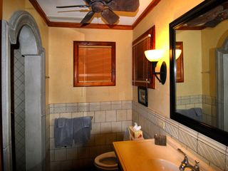 Playa Langosta condo photo - The guest bath has the same teak, stonework, and arches as the master bath.