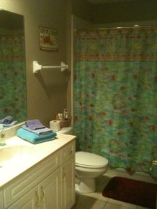 Fernandina Beach condo rental - The second bath has a standard tub/shower combo.