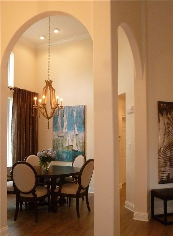 View into new upscale dining room with fabulous artwork.