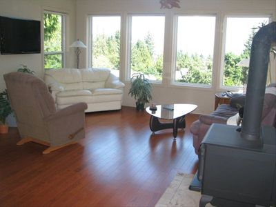 welcoming living room with woodstove, HDTV, PVR and great ocean views