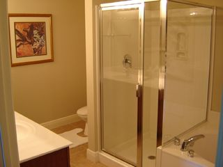 Destin condo photo - Glass shower, double vanity & tub with Oceanview