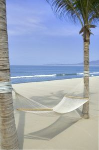 Relax in your own private hammock beachside and have staff bring you a beverage!