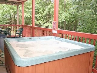 Sevierville cabin photo - Relax in the bubbly hot tub big enough for six people