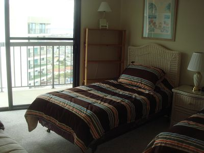 2nd bedroom overlooks ocean city and has 1 twin, 1 double and 1 futon