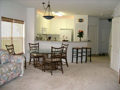 dwnstrs. living area,couch,(t.v. cabinet & lanai not seen)kitchen,pantry&1/2bath