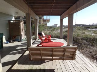 Cape San Blas house photo - Porch swing, table and chairs on the grill deck