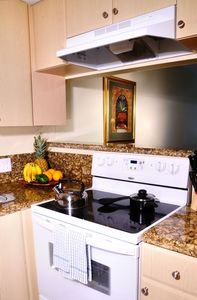 Kitchen with Granite Counter-tops and Ceramic-top Stove