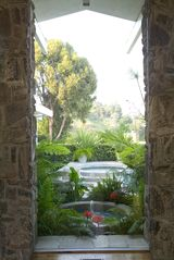 Hollywood estate photo - 12 ft Glass Atrium Overlooking Fountains & Pool