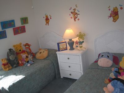 Winnie the Pooh themed twin room with dress up clothes in closet. PS2 n TV.