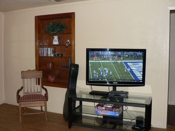 HD Flatscreen TV w/cable, dvd, dvd library, guitar and family board games