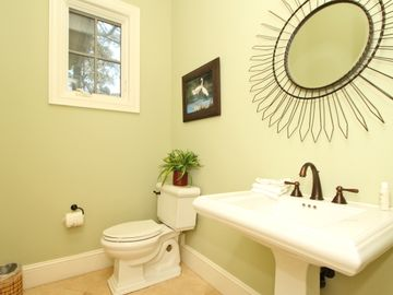 Powder room off entry foyer