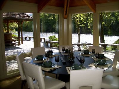 "River view dining at the 72"" round dining table..."