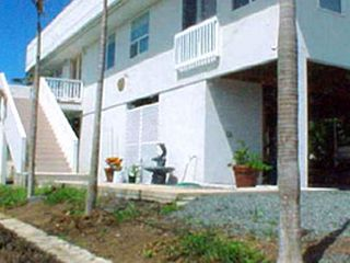 Kailua house photo - The exterior of the modern beach house overlooking Kailua Bay.