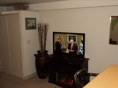 "New 42"" flat screen w/premium cable sitting on electric electric fireplace."
