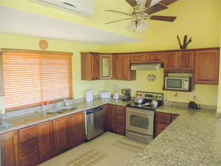 Playa Flamingo townhome photo - Fully equipped kitchen, stainless steel appliances