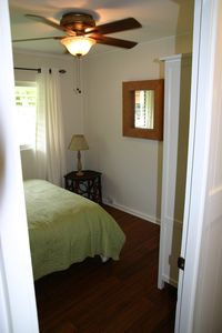 Ground floor guest room with queen size bed and own bathroom across the hallway
