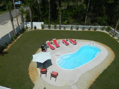 Beautiful Pool area with fenced yard and grill area