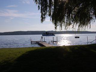 Skaneateles Lake, Skaneateles cottage photo - Dock at sunset. With cruise boat in view.