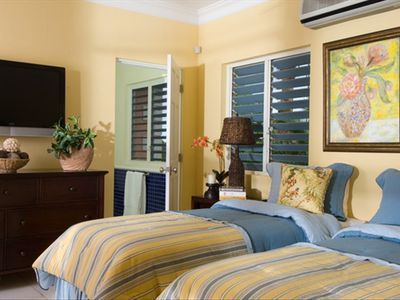 Charming twin bedroom suite with flat screen television