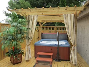 Bubbling romantic hot tub on the hideaway romantic deck...