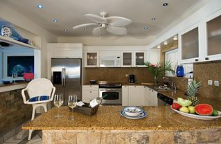 Orient Bay villa photo - Modern kitchen with all stainless appliances.