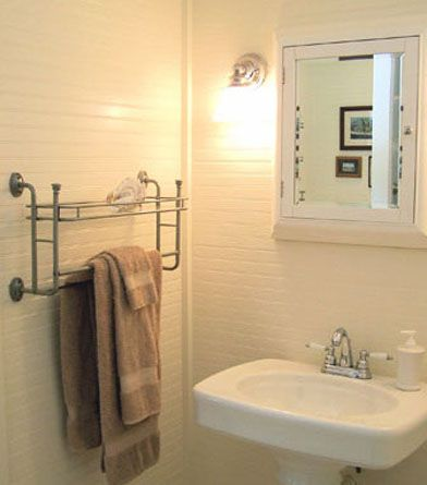 Bright white family shower room with washer/dryer facilities.