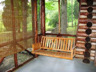 Farmville cabin photo - Swing away your cares on front porch overlooking the lake