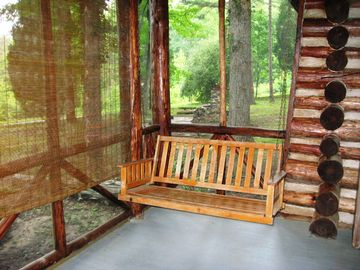 Swing away your cares on front porch overlooking the lake