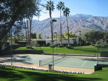 Palm Springs condo rental - View across tennis court and grounds to the mountains