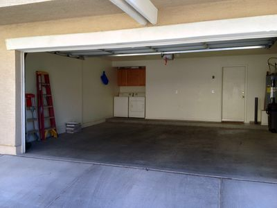 2 Car garage with remote opener. Street parking is also available for guests