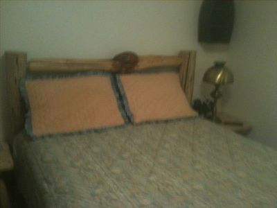 A sweet upstairs bedroom with a new pine queen bed, books & games in the closet!