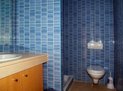 Bathrooms are beautifully tiled and furnished.