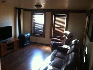 Williams house rental - couch with 2 recliners and additional recliner.